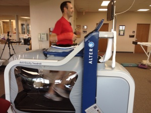 "Running in the ""Alter-G"" treadmill (at less than my body weight) with my cast still on."