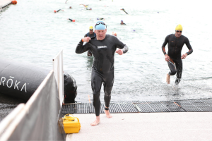 Coming out of the water for T1, sporting a crabby face based on my swim time...